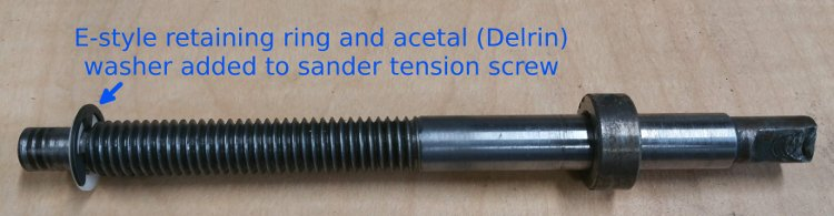 Tension screw modified to accept an E-style retaining ring & acetal (Delrin) washer to prevent wear of threads on inside of casting
