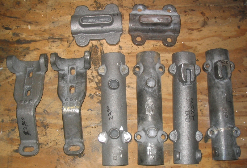 The new castings next to the repaired parts used as patterns as received from Cattail foundry