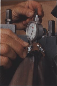 A cutterhead gauge enables knives to be set consistently to within one or two thousandths of an inch. The wing nuts on the base allow plunger height adjustment.